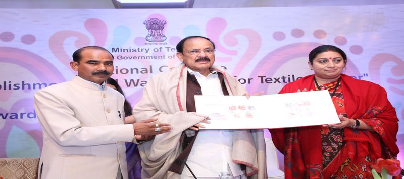 Image of  Presentation of Commrative Postal stamps on GI crafts to Hon'ble Vice President of India Shri Venkaiah Naidu in presence of Hon'ble Minister of Textiles Smt. Smriti Zubin Irani on 6th Jan 2019 during National Textile Conclave at Hotel Taj Mahal, New Delhi.